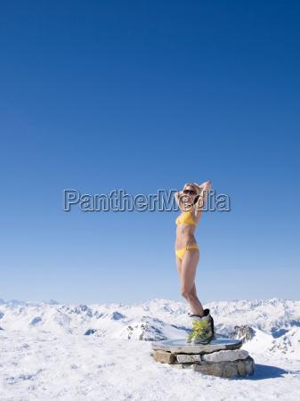 woman in bikini on mountain top