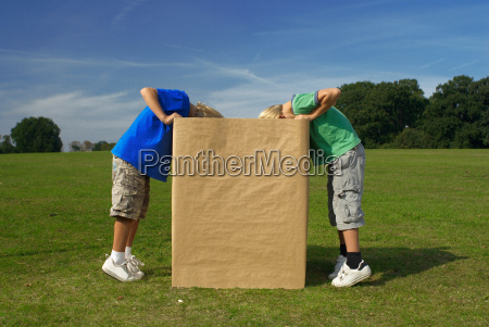 two boys looking into box