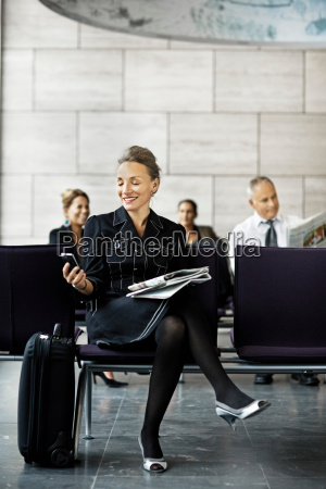 business woman with a suitcase waiting