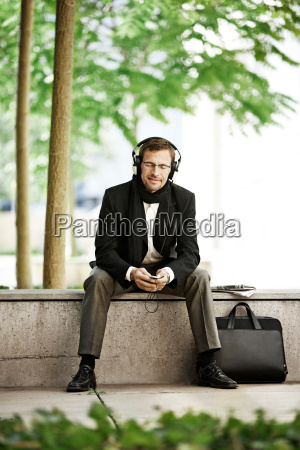 man listening to music on coffee