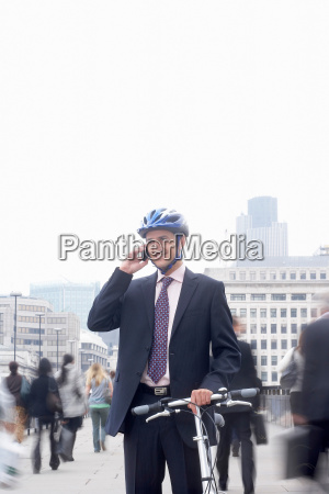 business man with bicycle mobile