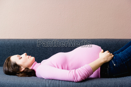 pregnant woman laying on couch