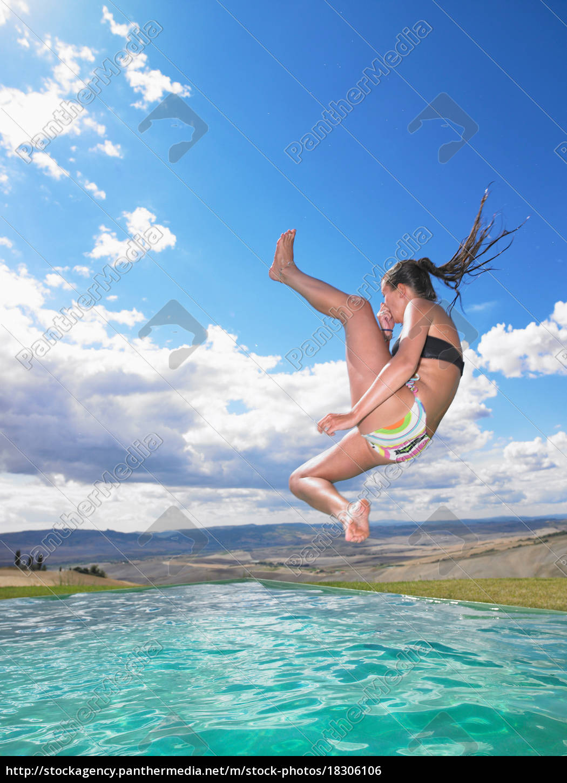 woman, jumping, in, swimming, pool - 18306106