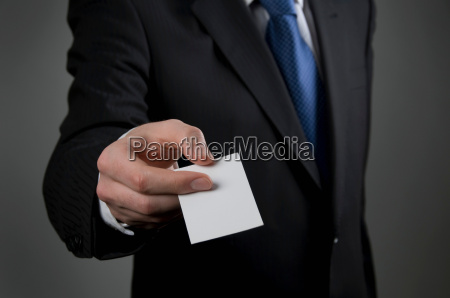male holding business card