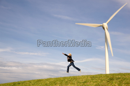 man jumping in front of wind