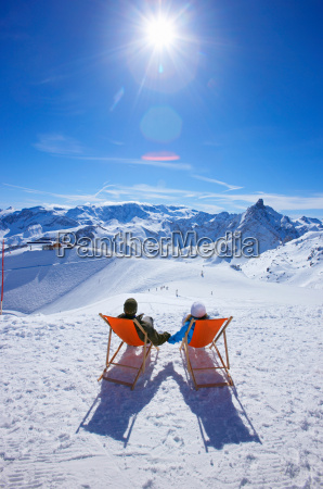 couple reclining in deck chairs