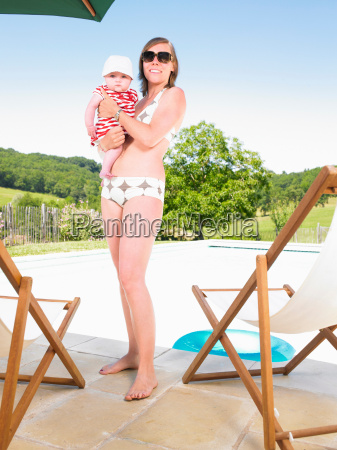 young woman and child by pool