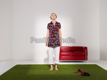 woman standing on grass in green