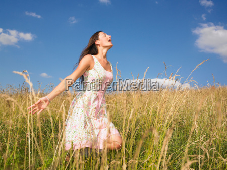 woman running in field of high