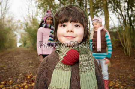 boy and two girls on country