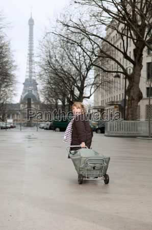 girl running with shopping cart