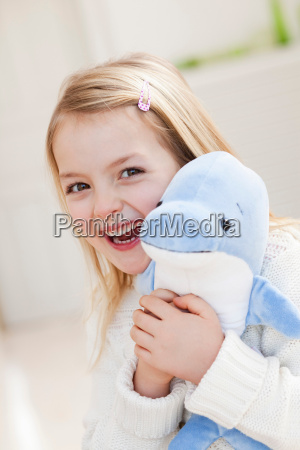 young girl with dolphin