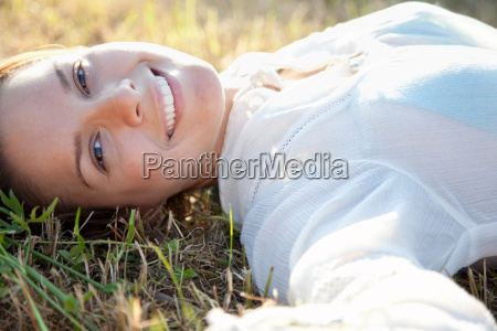 woman lying in grass in country