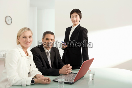 a portrait of three colleagues