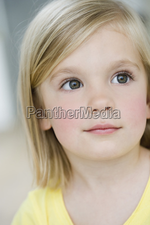 young girl looking interested