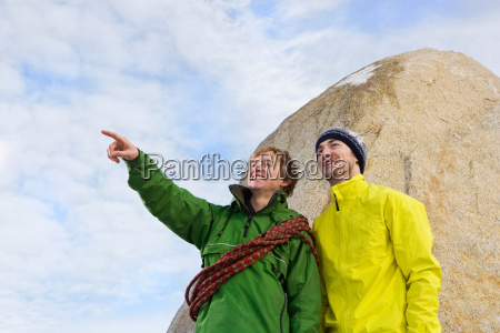 portrait of 2 climbers one pointing