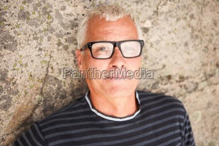 middle aged man on rocks portrait