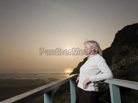 mature woman looking across sea