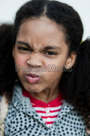 young girl making face at viewer