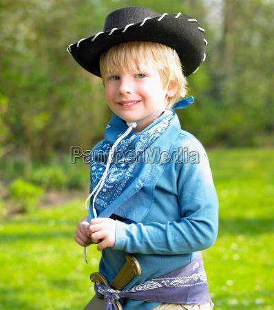 boy wearing a cowboy costume