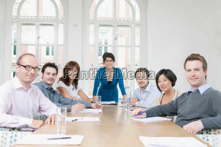 portrait of group at conference table