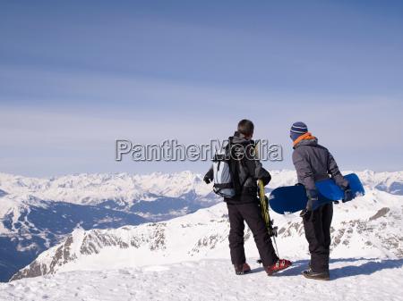 two men viewing mountains