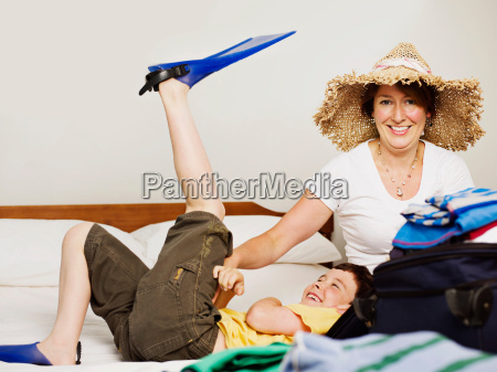 a mother and son packing for