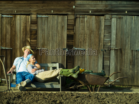 a couple relaxing in an allotment