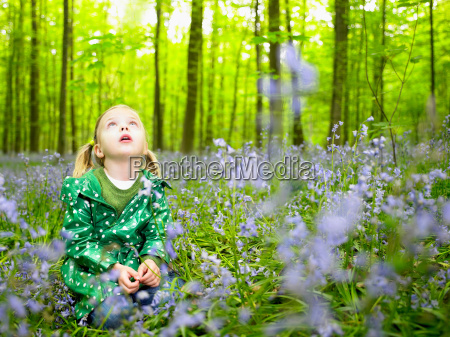 girl looking up in the woods
