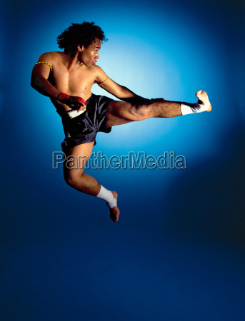 man doing jumping side kick