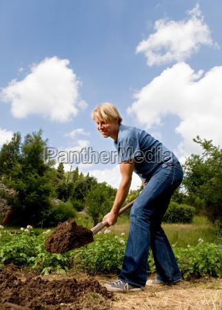 man digging in garden
