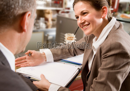 woman and man having discussion at