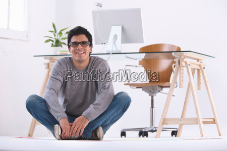 man sitting on the floor smiling