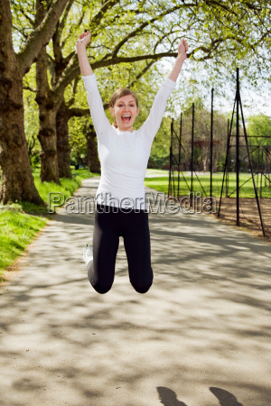 a young woman jumping up in
