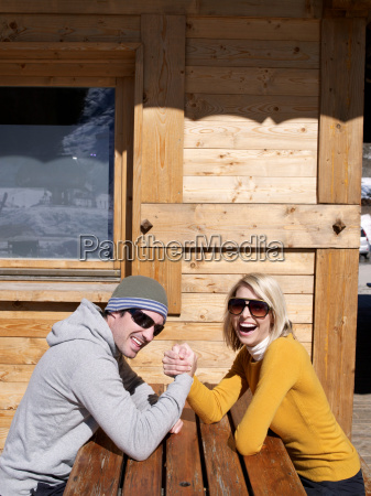 man and woman arm wrestle