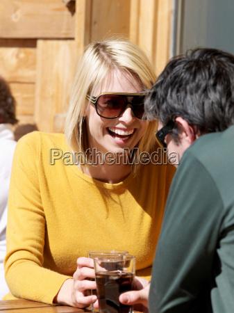 woman and man enjoying drink