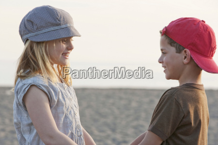 boy and girl holding hands at