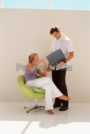 business people using laptop together