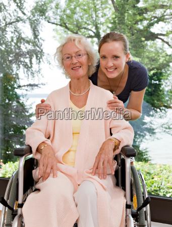 woman touching senior womans shoulders