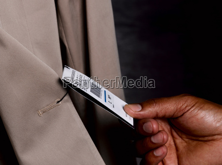 business man looking at price tag