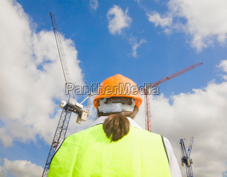 back of woman at building site