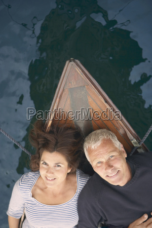 middle aged couple on boat portrait