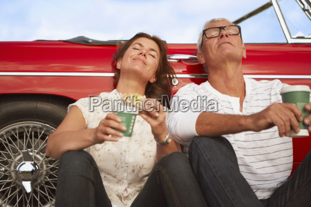 couple with car coffee break