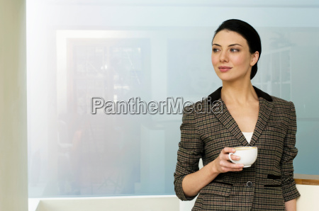 businesswoman holding coffee cup