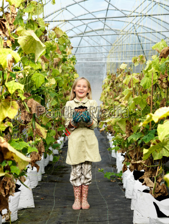 girl with plant in green house