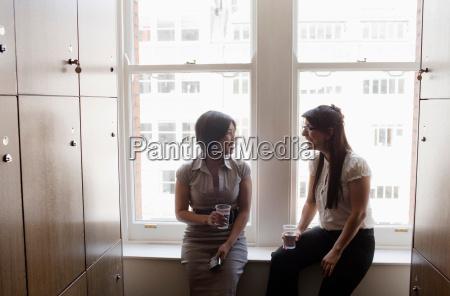 two business women talking in a
