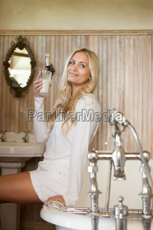woman drinking milk in bathroom