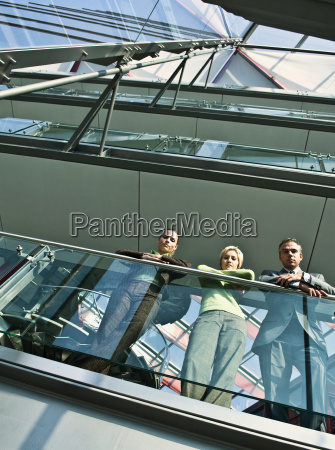 business people standing on balcony