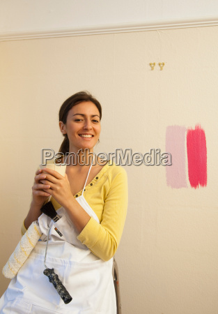 woman drinking coffee during decorating