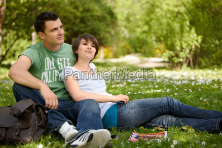 young romantic couple in a park